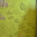 closeup of part of the banner signed by staff